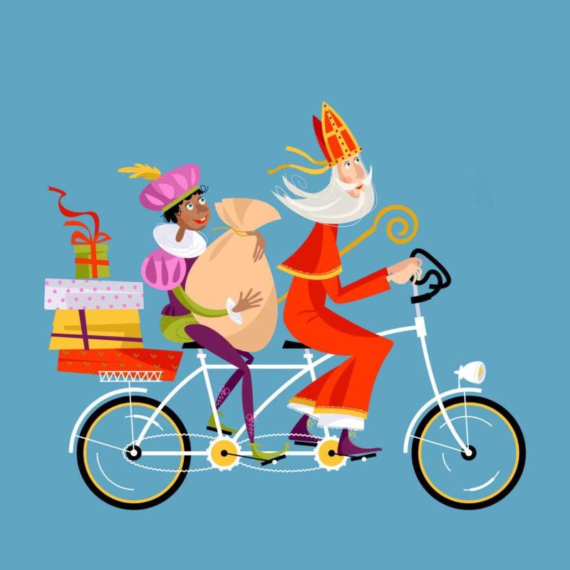Christmas in Holland. Sinterklaas and his helper deliver gifts on a tandem Bicycle.